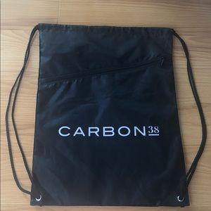 NWOT Carbon38 Black drawstring bag w/ front zipper